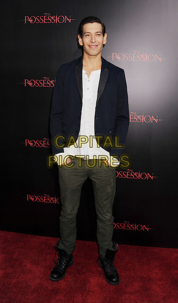 "Matisyahu.""The Possession"" Los Angeles Premiere held at Arclight Cinemas, Hollywood, California, USA..August 28th, 2012.full length shirt suit jacket blue hands in pockets black white jeans denim .CAP/ROT/TM.©Tony Michaels/Roth Stock/Capital Pictures"