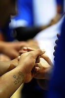 Saints players clasp hands before returning to the court from a timeout. NBL Semifinal - Wellington Saints v Nelson Giants at TSB Bank Arena, Wellington, New Zealand on Friday, 15 July 2011. Photo: Dave Lintott / lintottphoto.co.nz