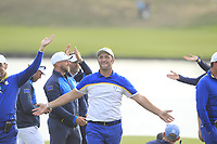 Jon Rahm (Team Europe) celebrates Europe's victory on the 18th green with the Icelandic Clap during the Sunday Singles of the Ryder Cup, Le Golf National, Ile-de-France, France. 30/09/2018.<br /> Picture Thos Caffrey / Golffile.ie<br /> <br /> All photo usage must carry mandatory copyright credit (© Golffile | Thos Caffrey)