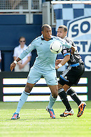 Kansas City forward Teal Bunbury (9) controls the ball in front of San Jose defender Jason Hernandez,.. Sporting Kansas City defeated San Jose Earthquakes 2-1 at LIVESTRONG Sporting Park, Kansas City, Kansas.