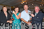 Silver Couple.---------------.Husband and wife Tresa and Martin Rice(centre)accept their Presidents prize at CastleGregory golf and fishing club last Friday night in the specially erected marquee on the golf course car park.L-R Joan Ferritor(lady President)Tresa Rice(lady presidents prize winner)Martin Rice(Mens presidents prize winner)and Gerard Callinan(president of Castlegregory golf and fishing club).   Copyright Kerry's Eye 2008