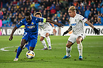 GETAFE, SPAIN - DECEMBER 12: FC Krasnodar's Cristian Ramírez and Getafe CF's  Djene Dakoman in action during the UEFA Europa League group C match between Getafe CF and FK Krasnodar at Coliseum Alfonso Perez on December 12, 2019 in Getafe, Spain. <br /> (ALTERPHOTOS/David Jar)