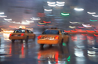 Taxis Passing Thru Herald Square on a Wet Evening, Midtown Manhattan, New York City, New York State, USA<br />