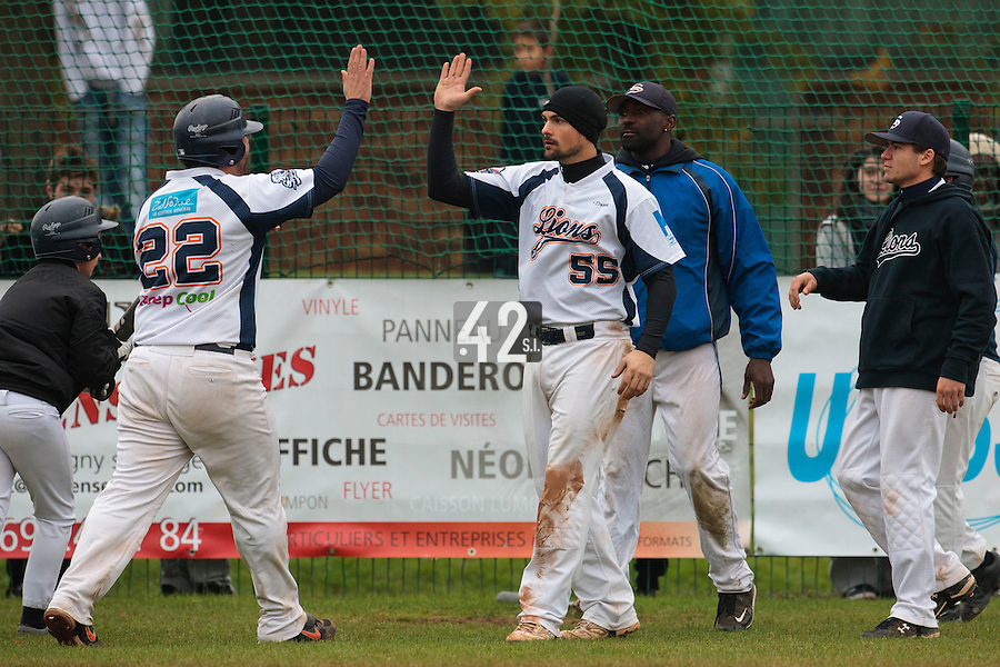 17 October 2010: Florian Peyrichou of Savigny congratulates Vincent Ferreira during Rouen 10-5 win over Savigny, during game 2 of the French championship finals, in Savigny sur Orge, France.