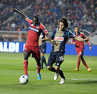 Chicago Fire forward Dominic Oduro (8) battles for the ball with Philadelphia Union midfielder Gabriel Farfan (15).  The Chicago Fire defeated the Philadelphia Union 1-0 at Toyota Park in Bridgeview, IL on March 24, 2012.