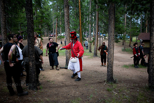 """A discus throwing tournament at a LARP event outside Conifer, Colo...The Nero Empire Live Action Role Players (LARP) gather for a three day LARPING event in forest land outside of Conifer, Colo.  LARPING is a scenario-based event where participants create characters for themselves and participate in play based around that theme.  Characters form alliances, fight for common goals, and can be """"killed."""""""