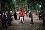 "A discus throwing tournament at a LARP event outside Conifer, Colo...The Nero Empire Live Action Role Players (LARP) gather for a three day LARPING event in forest land outside of Conifer, Colo.  LARPING is a scenario-based event where participants create characters for themselves and participate in play based around that theme.  Characters form alliances, fight for common goals, and can be ""killed."""