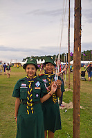 Scouts from Thailand are taking down the flags at the Flag ceromony