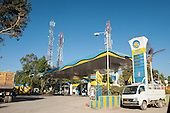 Amritsar, Punjab, India. Modern roadside Bharat Petroleum petrol service station in yellow and blue.