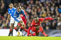 12th March 2020, Ibrox Stadiu, Glasgow, Scotland; Europa League football, Glasgow Rangers versus Bayer Leverkusen;  Glasgow's Glen Kamara and Leverkusen's Moussa Diaby fight for the ball.