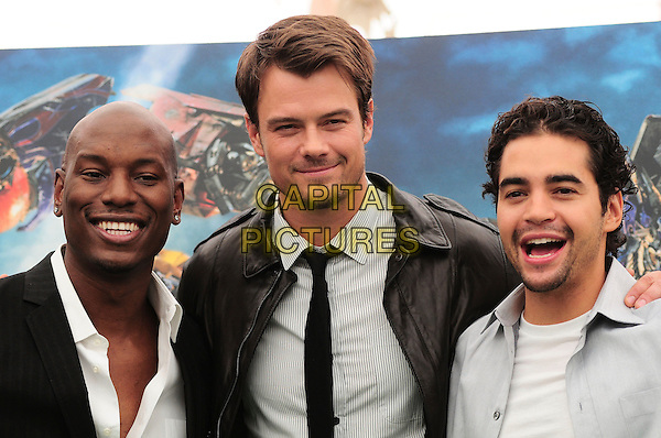 "TYRESE GIBSON, JOSH DUHAMEL & RAMON RODRIGUEZ.Photocall for ""Transformers: Revenge Of The Fallen"" .in Rome, Italy, 11th June 2009..portrait headshot beard facial hair  black leather jacket tie smiling white shirt.CAP/CAV.©Luca Cavallari/Capital Pictures"