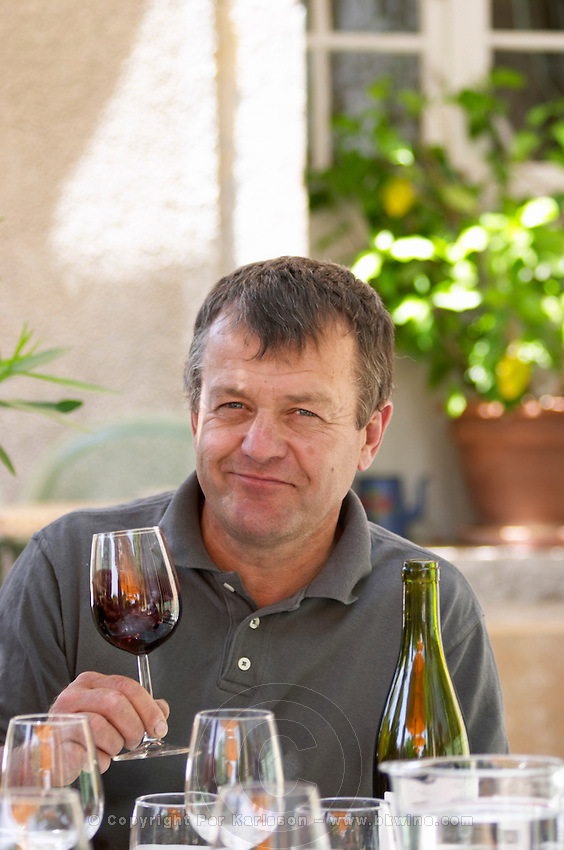 André Leenhardt Domaine Cazeneuve in Lauret. Pic St Loup. Languedoc. Owner winemaker. Tasting wine. France. Europe. Wine glass.