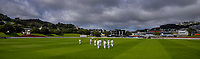 The teams walk out at the start of day one of the Plunket Shield cricket match between the Wellington Firebirds and Otago Volts at Basin Reserve in Wellington, New Zealand on Monday, 21 October 2019. Photo: Dave Lintott / lintottphoto.co.nz