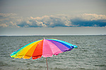 Hammonasset Beach State Park, CT. Rainbow umbrella, ocean and sky.