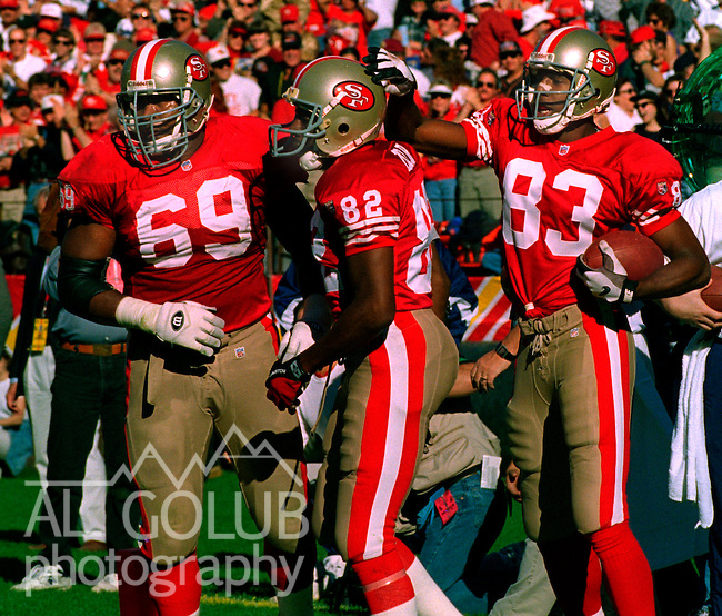 San Francisco 49ers vs. St. Louis Rams at Candlestick Park Sunday, November 26, 1995.  49ers beat Rams  41-13.  San Francisco 49ers guard Rod Milstead (69), wide receiver John Taylor (82) and wide receiver J.J. Stokes (83).