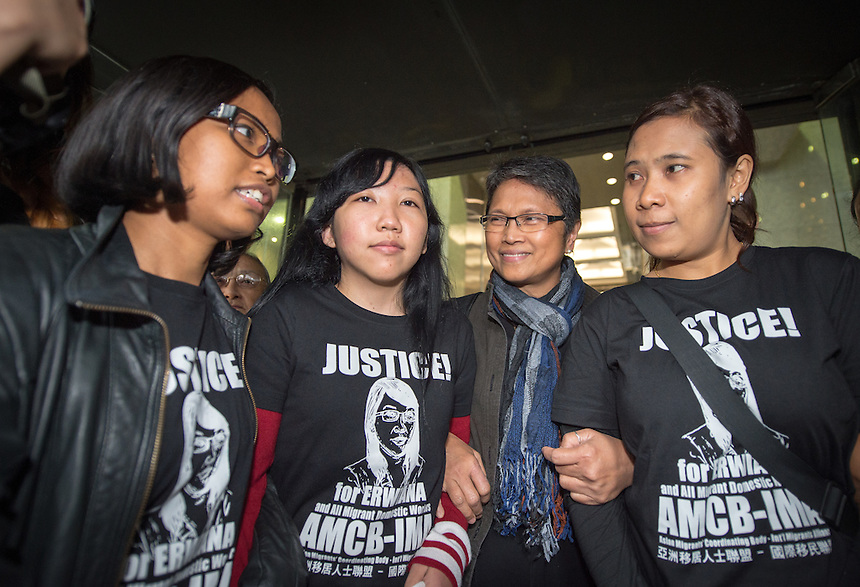 Abused Indonesian domestic helper Erwiana Sulistyaningsih leaves the District Court in Wan Chai with Cynthia Abdon-Tellez of Mission for Migrant Workers (right) after seeing her former employer sentenced to 6 years jail.<br /> 27th February 2015. 27.02.15<br /> &copy;Jayne Russell