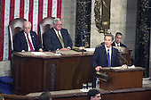 """Prime Minister Tony Blair of Great Britain addresses a Joint Session of the United States Congress in the U.S. Capitol in Washington, DC on July 17, 2003.  The Prime Minister said America must """"listen as well as lead"""" in the fight against terrorism. Behind Prime Minister Blair are U.S. Vice President Dick Cheney, left, and the Speaker of the U.S. House of Representatives J. Dennis Hastert (Republican of Illinois), right.<br /> Credit: Ron Sachs / CNP"""