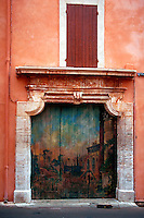 A painted exterior door on a French stucco building. Rousillon, France.