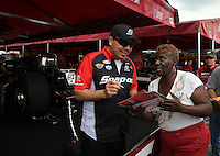 May 10, 2013; Commerce, GA, USA: NHRA fan gets an autograph from funny car driver Cruz Pedregon during qualifying for the Southern Nationals at Atlanta Dragway. Mandatory Credit: Mark J. Rebilas-