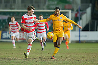 Joe Wright of Doncaster Rovers and Jaanai Gordon of Newport County during the Sky Bet League 2 match between Newport County and Doncaster Rovers at Rodney Parade, Newport, Wales on 10 February 2017. Photo by Mark  Hawkins / PRiME Media Images.