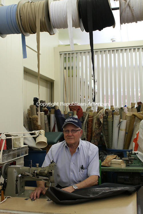 WATERTOWN, CT, 10 June 2015 - 061015LW01 - Ron Plourde works on the sewing machine he's owned for 40 years at his new shop, Upholstery by Ron/ Fredricks at 737 Main St. in Watertown. Laraine Weschler Republican-American