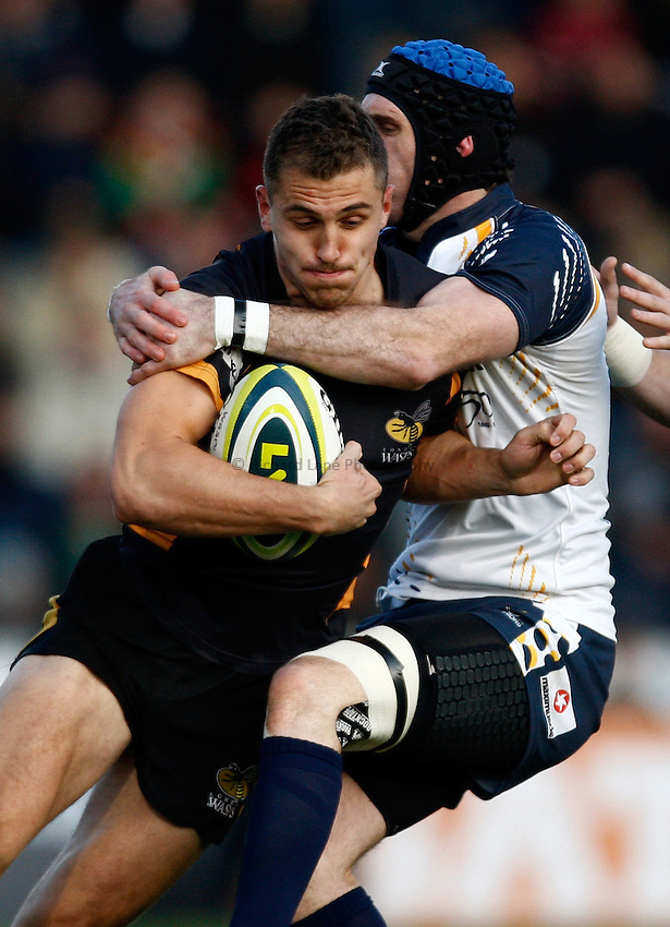 Photo: Richard Lane/Richard Lane Photography. London Wasps v Worcester Warriors. LV= Cup. 18/11/2012. Wasps' Jack Wallace is tackled by Warriors' Jon Clarke.