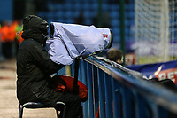 A photographer braving the elements during the Sky Bet League 1 match between Gillingham and Fleetwood Town at the MEMS Priestfield Stadium, Gillingham, England on 27 January 2018. Photo by David Horn.