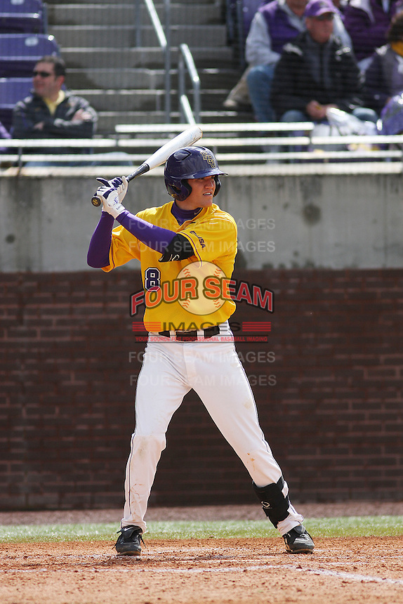 East Carolina University Pirates infielder Jack Reinheimer #8 at bat during a game against the Stony Brook Seawolves at Clark-LeClair Stadium on March 4, 2012 in Greenville, NC.  East Carolina defeated Stony Brook 4-3. (Robert Gurganus/Four Seam Images)