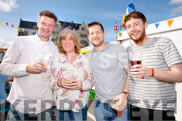 Stephen and Angela Sweeney (Donegal) with Kevin O'Shea (Cahersiveen), Ray Macken (Mullingar), and Anna Vilaro (Killarney), enjoying the atmosphere at Killarney Beerfest, at the INEC, Killarney on Saturday evening last.