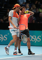 Feliciano Lopez (ESP) and Marc Lopez (ESP)(4) action against  Pierre-Hugues Herbert(FRA) and Nicolas Mahut (FEA)(1)<br /> in their Edberg/ Jarryd Group  match during Day Two of the Barclays ATP World Tour Finals 2015 played at The O2 Arena, London on November 14th  2016