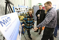 Shane Hall (from right), ammonia refrigerant instructor at Northwest Technical Institute, discusses Thursday, February 13, 2020, with Rhett Hall (cq), and his (cq shane's) wife Jessica an expansion of the ammonia refrigeration, industrial maintenance and boiler operation facility on the campus in Springdale. The school held a formal groundbreaking ceremony for the expansion Thursday.The school is also in the process of building a facility dedicated to welding, which is scheduled to open this fall. Check out nwaonline.com/200214Daily/ and nwadg.com/photos for a photo gallery.<br /> (NWA Democrat-Gazette/David Gottschalk)