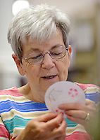 NWA Democrat-Gazette/BEN GOFF &bull; @NWABENGOFF<br /> Barbara Thorson of Bella Vista works on a paper embroidery piece on Monday Aug. 3, 2015 during the weekly meeting of the B&rsquo;Creative Stitchers at the Bella Vista Public Library.