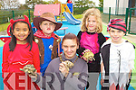 Pupils from Raheen NS getting to know snakes and tortoises when the animal roadshow arrived at the school on Friday l-r: Sinead Segehan, Conor Hobbs, Marie Fleming, Ciara Falls and Jamie O'Connor. Raheen NS will be holding a fundraising Halloween dance in Darby O'Gills on Friday 30th October..