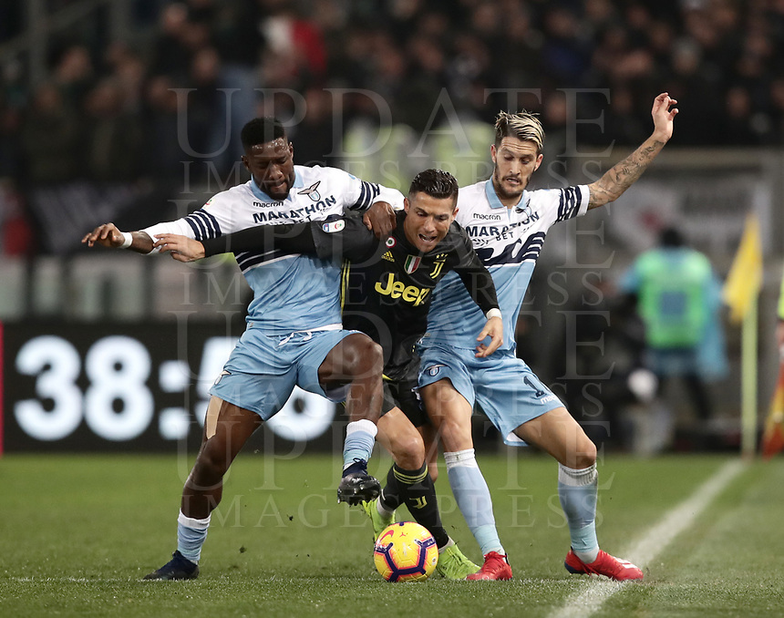 Football, Serie A: S.S. Lazio - Juventus, Olympic stadium, Rome, January 27, 2019. <br /> Juventus' Cristiano Ronaldo (c) in action with Lazio's Bastos (l) and Luis Alberto (r) during the Italian Serie A football match between S.S. Lazio and Juventus at Rome's Olympic stadium, Rome on January 27, 2019.<br /> UPDATE IMAGES PRESS/Isabella Bonotto