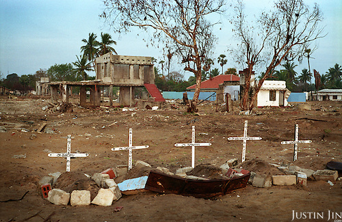 Five make-shift graves, marked by crucifixes, stand on the beach in the northeastern coast of Sri Lanka, an area ravaged first by civil war then by the tsunami. The crosses mark the deaths of a woman and her four children..The December 26, 2004 tsunami killed around 40,000 people along Sri Lanka's southern, eastern and northern shores, tearing thousands of families apart. .The bulk of the dead were women and children - husbands lost young brides and around 4,000 children lost one or both parents. .Even before the tsunami struck, people here in the northeast had already been displaced four times by the Tigers' two-decade war for autonomy. .In some places, the scars of war and the tsunami have become one. Remnants of walls torn down by waves are pockmarked with bullet holes and shrapnel from shells fired before a 2002 ceasefire plunged a civil war that killed over 64,000 people into limbo. ..
