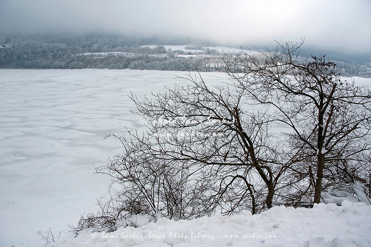 Fog over an icy lake in winter.