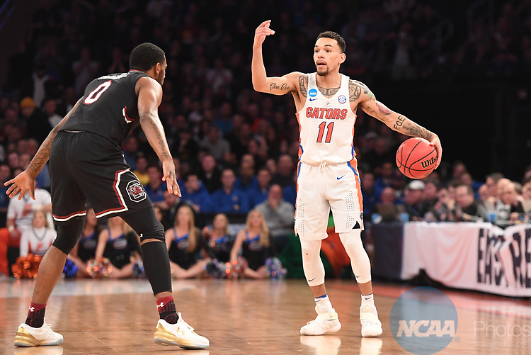 NEW YORK, NY - MARCH 26:  Chris Chiozza #11 of the Florida Gators is guarded Sindarius Thornwell #0 of the South Carolina Gamecocks during the 2017 NCAA Men's Basketball Tournament held at Madison Square Garden on March 26, 2017 in New York City. (Photo by Justin Tafoya/NCAA Photos via Getty Images)<br /> ***Local Caption***Chris Chiozza