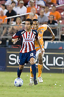 CD Guadalajara forward Sergio Avila (13) dribbles away from Houston Dynamo midfielder Ricardo Clark (13) during the group stage of the Superliga 2008 tournament at Robertson Stadium in Houston, TX on July 15, 2008.