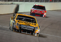 Nov. 16, 2008; Homestead, FL, USA; NASCAR Sprint Cup Series driver Matt Kenseth leads Jeff Gordon during the Ford 400 at Homestead Miami Speedway. Mandatory Credit: Mark J. Rebilas-