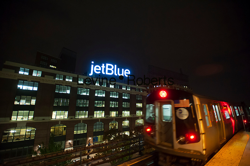 The giant JetBlueAirways  illuminated sign on the airlines headquarters in Long Island City in New York on Tuesday, October 23, 2012. The airline is scheduled to release its third quarter earnings on Thursday.  (© Richard B. Levine)