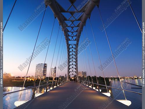 The Humber River Arch Bridge in Toronto during sunset also known as the Humber Bay Arch Bridge or the Gateway Bridge. Toronto, Ontario, Canada.