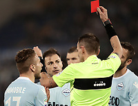 Calcio, Serie A: S.S. Lazio - A.S. Roma, stadio Olimpico, Roma, 15 aprile 2018. <br /> Lazio's Stefan Radu (c) is shown a red card by referee Paolo Mazzoleni during the Italian Serie A football match between S.S. Lazio and A.S. Roma at Rome's Olympic stadium, Rome on April 15, 2018.<br /> UPDATE IMAGES PRESS/Isabella Bonotto