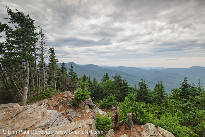 July 2016 - Storm clouds over the White Mountain National Forest from Mount Tecumseh in Waterville Valley, New Hampshire. The viewpoint seen here is from hikers doing unauthorized tree cutting. This mountain is named for the great Shawnee war chief, Tecumseh (1768–1813).
