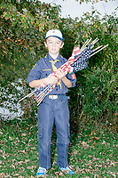 Portrait of Alex, age 8, a Bear Cub Scout in Belmont, Massachusetts, USA, on Sat., Oct. 14, 2017. Alex was involved in a flag retirement ceremony in Belmont, Massachusetts, USA, on Sat. Oct. 14, 2017. Flag retirement ceremonies are intended to give a dignified end to flags no longer fit to serve as a symbol for the United States of America. The ceremony was organized by Eagle Scout candidate Robert Mountain, 17, of Belmont Boy Scout Troop 66 as his Eagle Scout project.  The ceremony was held in park area surrounding Clay Pit Pond near Belmont High School.