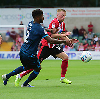 Lincoln City's Joe Morrell vies for possession with Bristol Rovers' Mark Little<br /> <br /> Photographer Chris Vaughan/CameraSport<br /> <br /> The EFL Sky Bet League One - Lincoln City v Bristol Rovers - Saturday 14th September 2019 - Sincil Bank - Lincoln<br /> <br /> World Copyright © 2019 CameraSport. All rights reserved. 43 Linden Ave. Countesthorpe. Leicester. England. LE8 5PG - Tel: +44 (0) 116 277 4147 - admin@camerasport.com - www.camerasport.com
