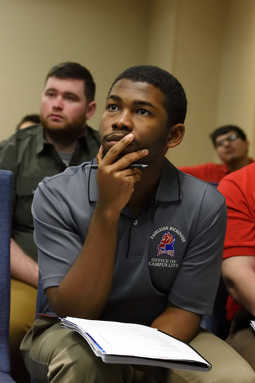 A student listening attentively.