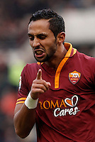 Calcio, Serie A: Roma-Genoa. Roma, stadio Olimpico, 12 gennaio 2014.<br /> AS Roma defender Mehdi Benatia, of Morocco, celebrates after scoring during the Italian Serie A football match between AS Roma and Genoa, at Rome's Olympic stadium, 12 January 2014. <br /> UPDATE IMAGES PRESS/Isabella Bonotto