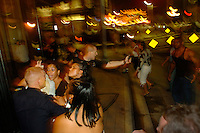 Hillsborough, Tampa, Fl 8/1/04-- YBOR 02 -- City of Tampa Police Department officers Dusty Rhodes, left, and Shannon Murphy, with mace, break up a melee while patrolling 7th Ave. in Ybor City. Fifty officers were on the streets Saturday. PHOTOS 2 OF ? IMAGES STAFF MICHAEL SPOONEYBARGER