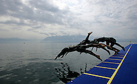 19 AUG 2005 - LAUSANNE, SWITZERLAND - Competitors practise their dive starts before the European Triathlon Championships. (PHOTO (C) NIGEL FARROW)