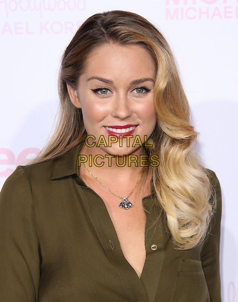LAUREN CONRAD .at The Teen Vogue 8th Annual Young Hollywood Party held at Paramount Studios in Hollywood, California, USA, October 1st 2010..portrait headshot green khaki shirt necklace red lipstick  bee bug necklace smiling                                                              .CAP/RKE/DVS.©DVS/RockinExposures/Capital Pictures.